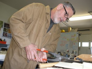 Roger V Thomas making the perfect cut on a piece of glass